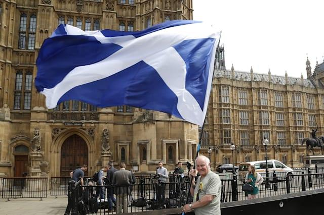 SNP MP's pose in front of Parliament following election