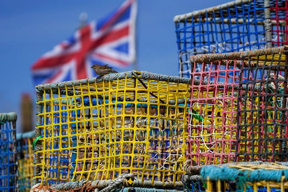 Empty fishing nets sit on the beach at Hastings, Sussex (Steve Parsons/PA) (PA Wire)