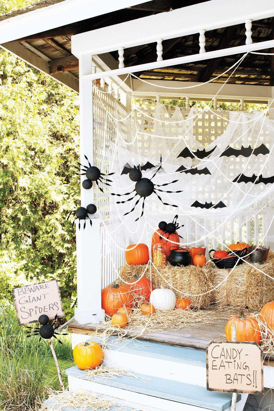 <p>Make your guests carefully maneuver through the web of giant spiders to reach a bowl of prized treats. Made of foam balls and chenille stems, these creepy creatures try to catch candy thieves in their web!</p>