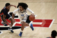 UCLA guard Tyger Campbell is defended by Pepperdine guard Darryl Polk Jr. during the second half of an NCAA college basketball game Friday, Nov. 27, 2020, in San Diego. (AP Photo/Gregory Bull)