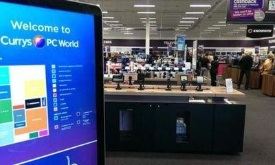 Dixons Carphone swings to a loss