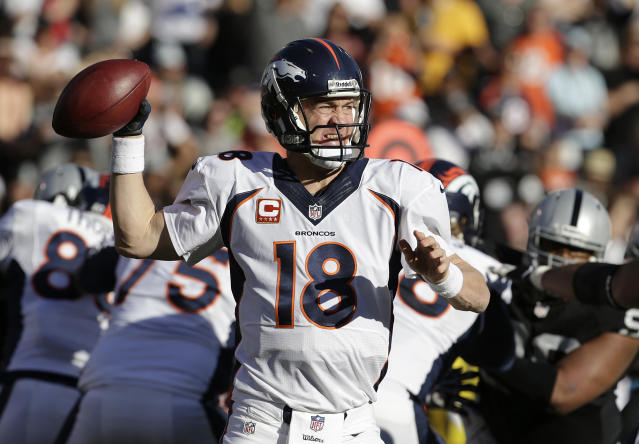Denver Broncos quarterback Peyton Manning (18) passes against the Oakland Raiders during the second quarter of an NFL football game in Oakland, Calif., Sunday, Dec. 29, 2013. (AP Photo/Tony Avelar)