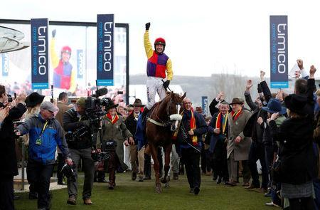 FILE PHOTO: Horse Racing - Cheltenham Festival - Cheltenham Racecourse, Cheltenham, Britain - March 16, 2018 Richard Johnson on Native River celebrates after winning the 15.30 Timico Cheltenham Gold Cup Chase Action Images via Reuters/Andrew Boyers/File Photo