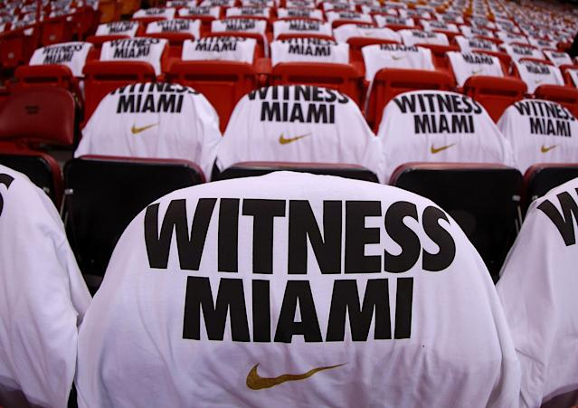 MIAMI, FL - APRIL 21: A view of the T-shirts given to fans during Game 1 of the Eastern Conference Quarterfinals of the 2013 NBA Playoffs between the Miami Heat and the Milwaukee Bucks at American Airlines Arena on April 21, 2013 in Miami, Florida. NOTE TO USER: User expressly acknowledges and agrees that, by downloading and or using this photograph, User is consenting to the terms and conditions of the Getty Images License Agreement. (Photo by Mike Ehrmann/Getty Images)