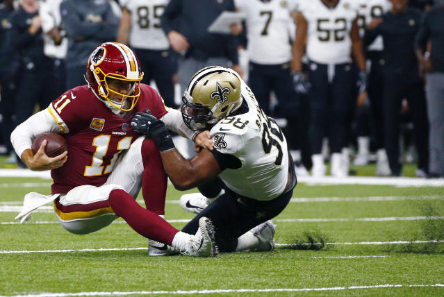 New Orleans Saints defensive tackle Sheldon Rankins (98) brings down Washington Redskins quarterback Alex Smith (11) in the first half of an NFL football game in New Orleans, Monday, Oct. 8, 2018. (AP Photo/Butch Dill)