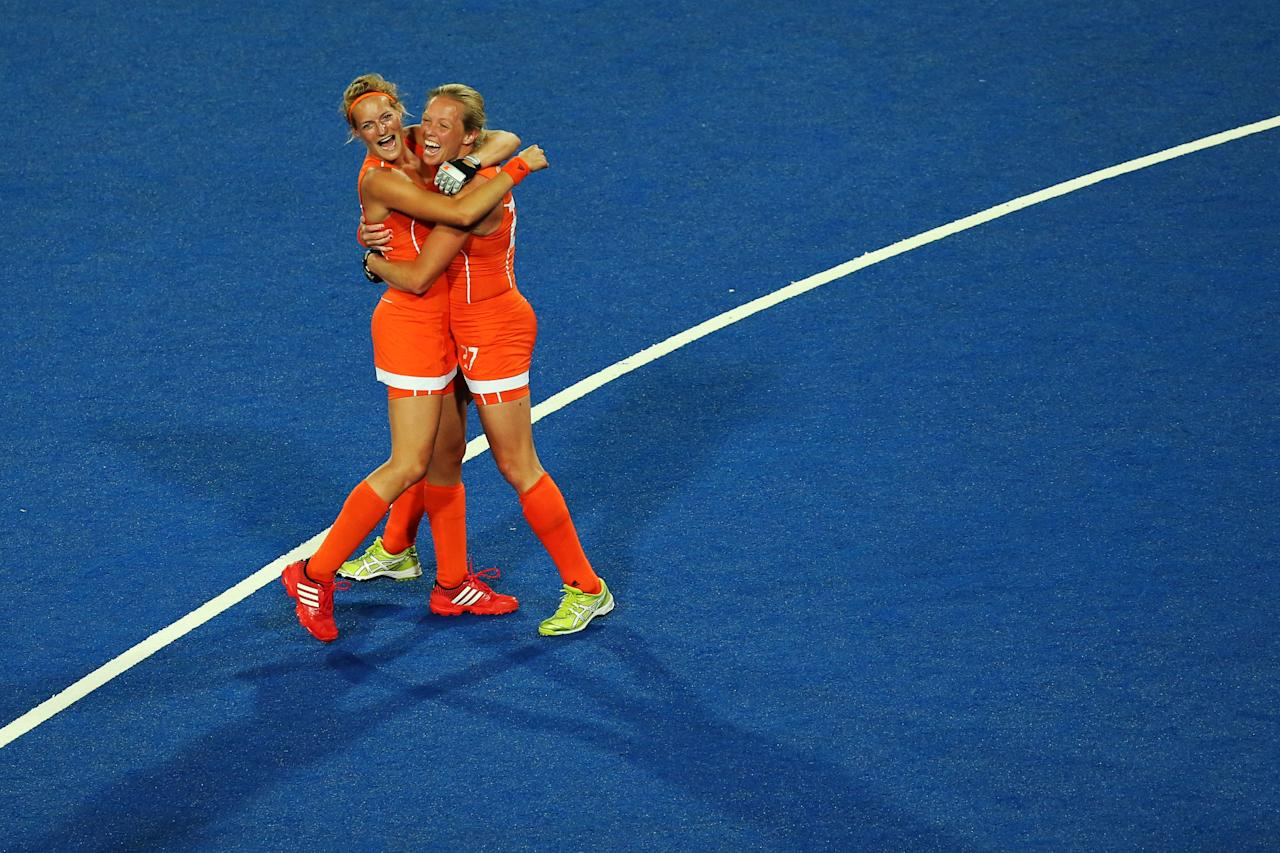 LONDON, ENGLAND - AUGUST 10:  Carlien Dirkse Van Den Heuvel #9 and Marilyn Agliotti #27 of Netherlands celebrate their 2-0 victory over Argentina to win the Women's Hockey gold medal match on Day 14 of the London 2012 Olympic Games at Hockey Centre on August 10, 2012 in London, England.  (Photo by Daniel Berehulak/Getty Images)