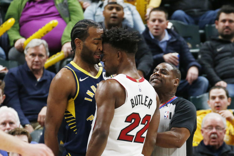 Jimmy Butler and T.J. Warren gave fans their money's worth in the midst of a blowout. (Brian Spurlock/Reuters)