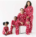 """<p><strong>SleepytimePJs</strong></p><p>Starting from $6.99</p><p><strong>$20.99</strong></p><p><a href=""""http://www.amazon.com/dp/B071VGKN93/?tag=syn-yahoo-20&ascsubtag=%5Bartid%7C10055.g.4946%5Bsrc%7Cyahoo-us"""" rel=""""nofollow noopener"""" target=""""_blank"""" data-ylk=""""slk:Shop Now"""" class=""""link rapid-noclick-resp"""">Shop Now</a></p><p>It doesn't get cozier than a onesie on Christmas morning. These are especially a good idea for kids who love zip-up pajamas. </p>"""