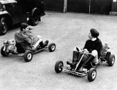 Prince Charles whizzing his little brother Prince Edward around on a go-kart in June 1969. Princess Anne is on the second go-kart. (AFP via Getty Images)