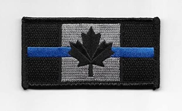 Saint John police tweeted that it has spoken with its officers following photos being posted on social media of officers at a protest wearing patches with a thin blue line going through the Canadian flag.  (amazon - image credit)