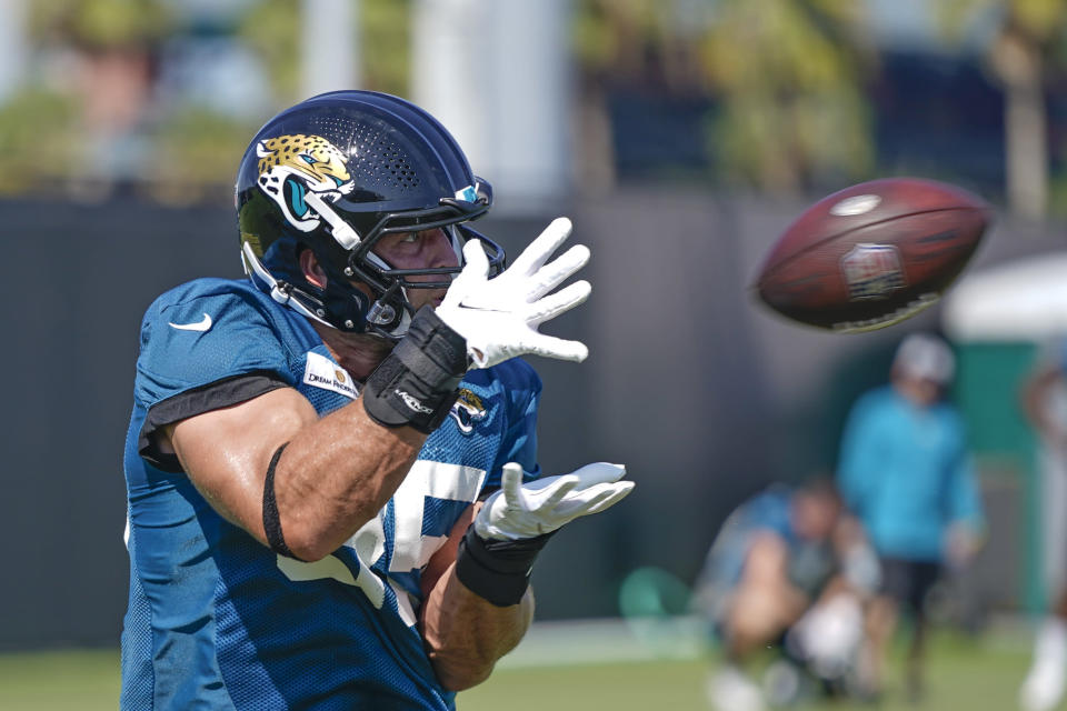 Jacksonville Jaguars tight end Tim Tebow makes a reception during a drill at NFL football practice, Saturday, July 31, 2021, in Jacksonville, Fla. (AP Photo/John Raoux)