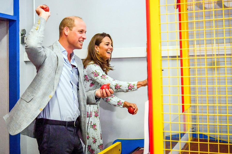 <p>Prince William and Kate Middleton have fun playing games at Island Leisure Amusement Arcade during their visit to Barry Island in South Wales on Wednesday.</p>