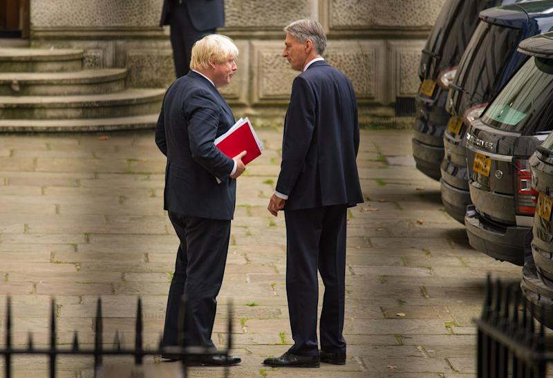 Boris Johnson, left, and Philip Hammond belong to rival Tory camps on Brexit. Photo: Dominic Lipinski/PA/Getty