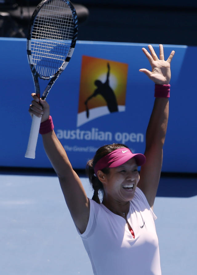 Li Na of China celebrates after defeating Eugenie Bouchard of Canada during their semifinal at the Australian Open tennis championship in Melbourne, Australia, Thursday, Jan. 23, 2014. (AP Photo/Aijaz Rahi)