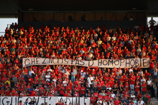 "FILE - In this Saturday, Aug. 31, 2019 file photo, Nimes fans hold up a banner that reads ""with us no homophobia"" before the start of the French League One soccer match between Nimes and Brest at the Stade des Costieres in Nimes, southern France. Referees should no longer stop matches when there is homophobic chanting, urged French Football Federation president Nol Le Grat. (AP Photo/Daniel Cole, File)"