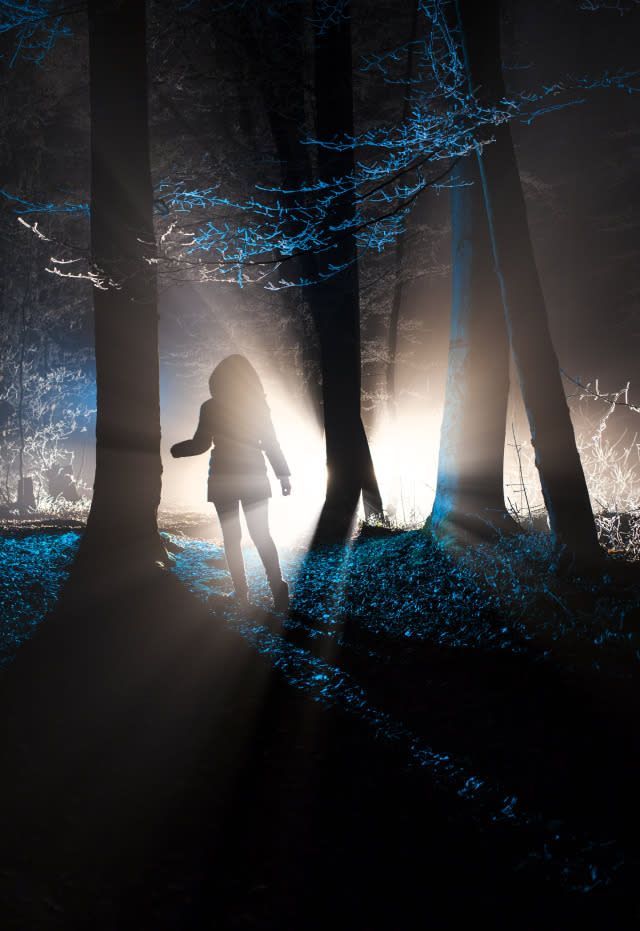 A girl in the dark forest.