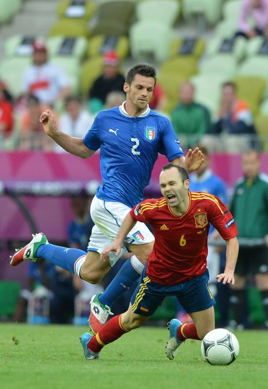 Spanish midfielder Andres Iniesta (R) vies with Italian defender Christian Maggio during the Euro 2012 championships football match Spain vs Italy on June 10, 2012 at the Gdansk Arena. AFP PHOTO / GABRIEL BOUYSGABRIEL BOUYS/AFP/GettyImages