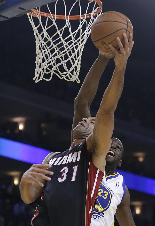 Miami Heat's Shane Battier (31) lays up a shot past Golden State Warriors' Draymond Green (23) during the first half of an NBA basketball game Wednesday, Feb. 12, 2014, in Oakland, Calif. (AP Photo/Ben Margot)
