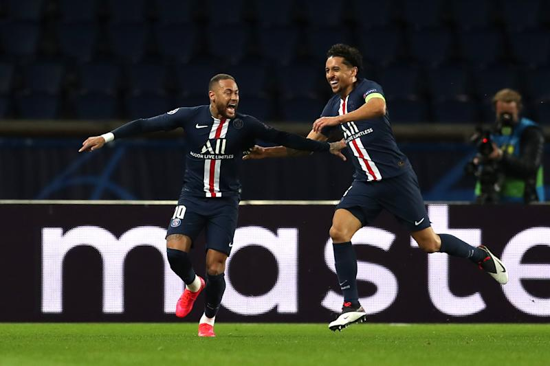 Neymar runs and celebrates with Marquinhos after scoring his team's first goal.
