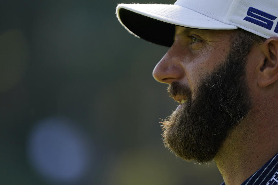 Dustin Johnson watches his tee shot on the 17th hole during the final round of the Masters golf tournament Sunday, Nov. 15, 2020, in Augusta, Ga. (AP Photo/Charlie Riedel)
