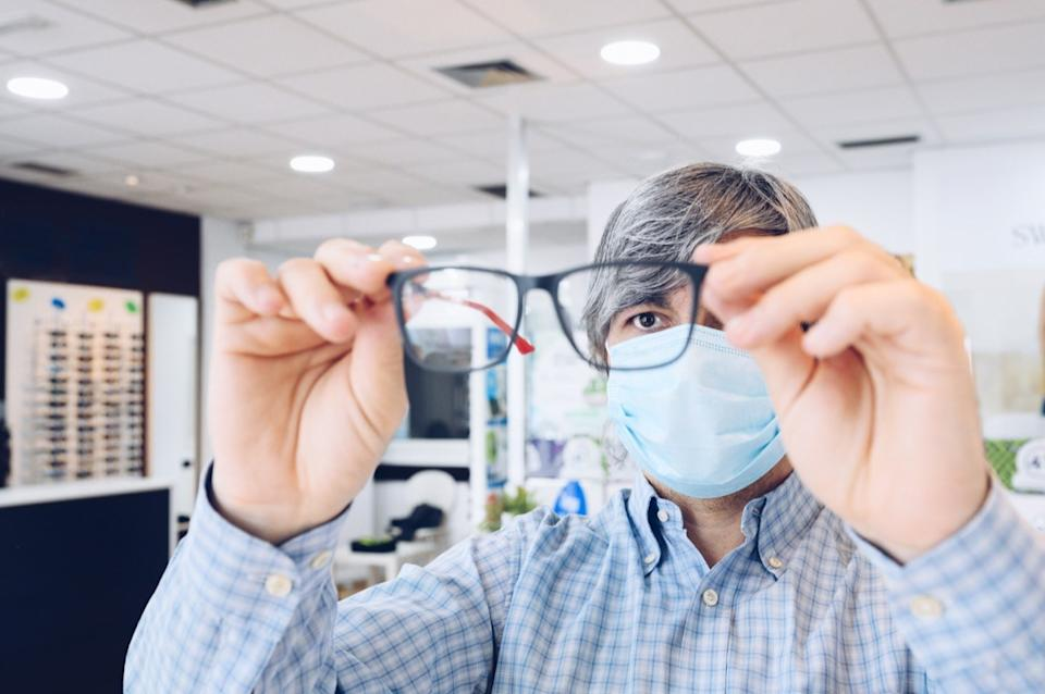 man with mask at opthamologist