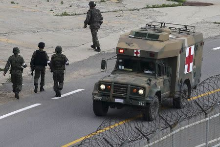A military ambulance transporting a conscript soldier who shot and killed five comrades, travels to a hospital in Goseong June 23, 2014. REUTERS/Han Jae-ho/News1