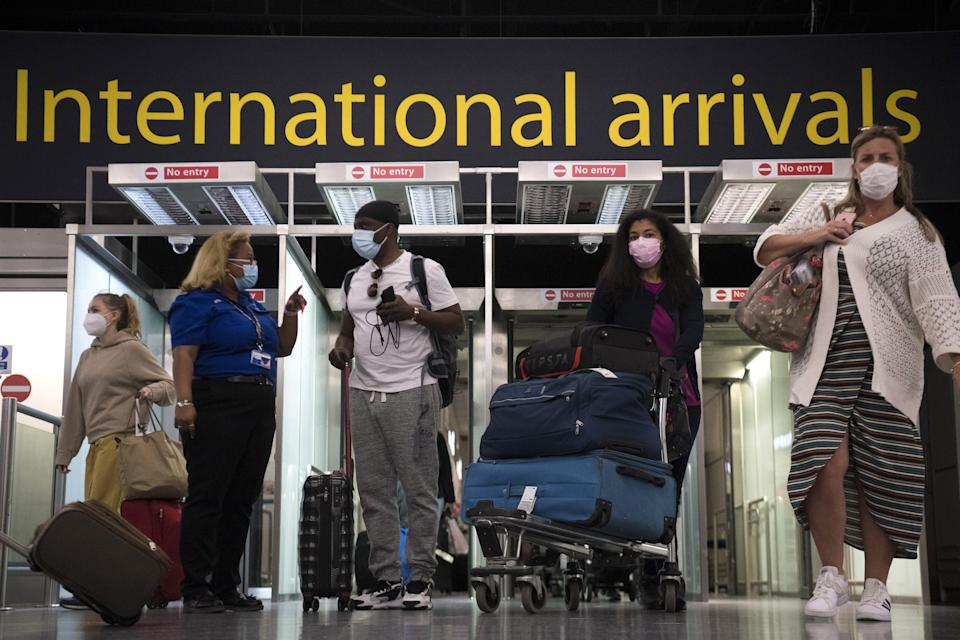 <p>Passengers arrive at Gatwick from Portugal</p> (PA Wire)
