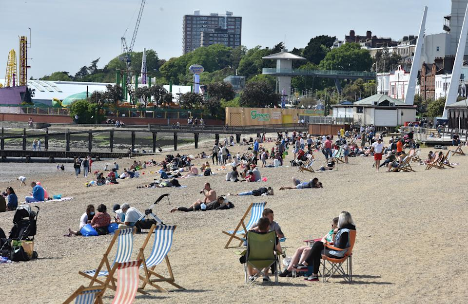 SOUTHEND ON SEA, ENGLAND - MAY 17: People flock to the beach to enjoy the sunshine and warm weather during the coronavirus, covid-19 pandemic on May 17, 2020 in Southend on Sea, England . The prime minister announced the general contours of a phased exit from the current lockdown, adopted nearly two months ago in an effort curb the spread of Covid-19. (Photo by John Keeble/Getty Images)