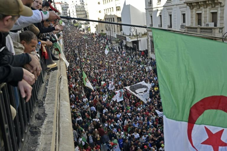 Anti-regime protesters marched through central Algiers on December 6, protesting against the upcoming presidential election (AFP Photo/RYAD KRAMDI                        )