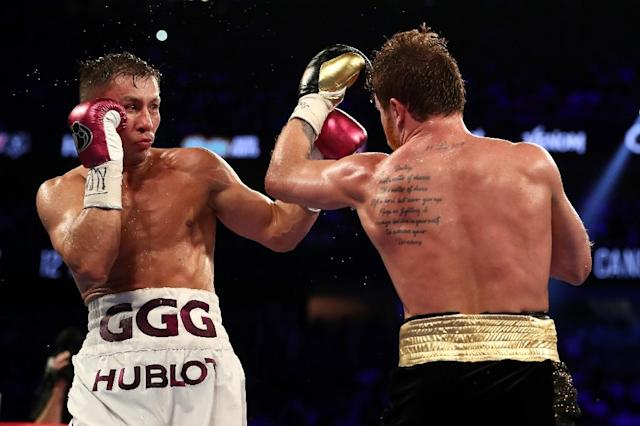 "The win by Saul ""Canelo"" Alvarez (R) ended Gennady Golovkin's dream of securing a record-breaking 21st consecutive defence of his middleweight titles. (AFP Photo/AL BELLO)"