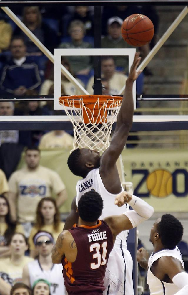 Pittsburgh's Talib Zanna, top, tries to block a shot by Virginia Tech's Jarell Eddie (31) during the first half of the NCAA college basketball game on Saturday, Feb. 8, 2014, in Pittsburgh. (AP Photo/Keith Srakocic)