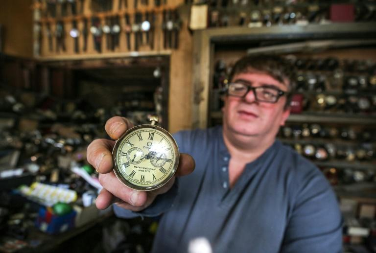 """Youssef Abdelkarim, who believes that a """"man's elegance begins with his watch"""", holds an antique pocket-watch"""