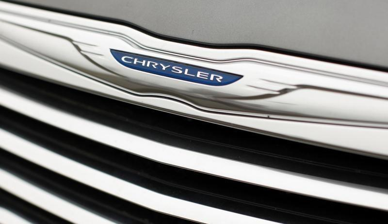 A Chrysler badge is pictured on a new car at a dealership in Vienna, Virginia