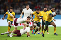 """Marika Koroibete of Australia breaks Georgia's defensive line to score his side's second try in a 27 - 8 win. Cameron Spencer (Getty Images) captured the despairing lunges of the Georgia defence: """"Koroibete is such a strong runner...I like the opposition players flying off him as he powers upfield."""""""