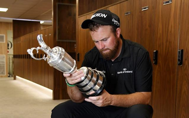 Lowry inspects the Claret Jug after his six-stroke victory at Portrush - R&A