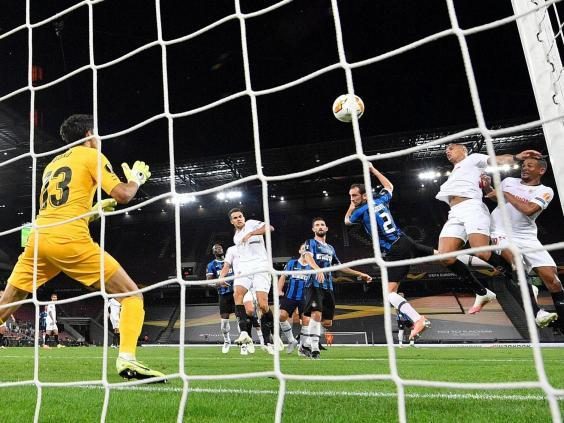 Diego Godin's header for Inter makes it 2-2 in the Europa League final (POOL/AFP via Getty Images)