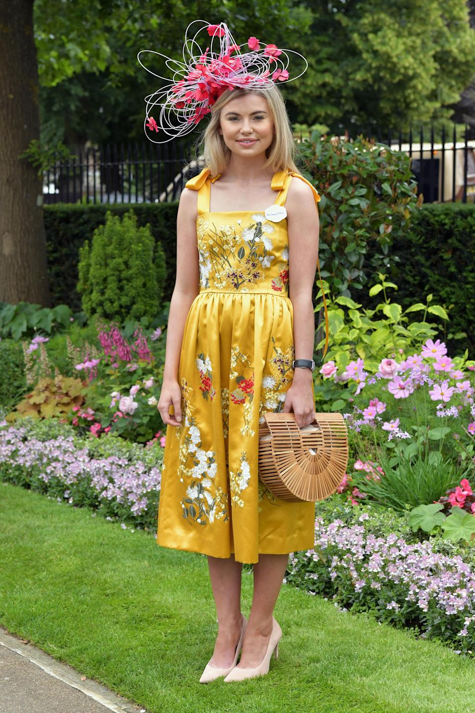 <p>Reality TV star Georgia Toffolo (Toff) enjoyed day two of the races in a cheerful yellow dress and ornate fascinator.<em> [Photo: Getty]</em> </p>