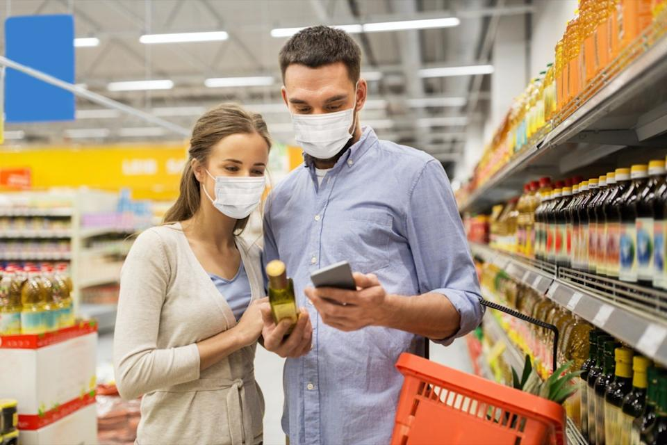 couple checking food label at the store