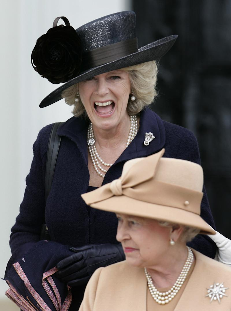 FILE - In this April 12, 2006 file photo, Britain's Camilla, the Duchess of Cornwall, top, laughs as members of the royal family including Queen Elizabeth II, bottom, and Prince Philip leave after the Sovereign's Parade at the Royal Military Academy Sandhurst in England where Prince Harry, received his military commission. Queen Elizabeth II has appointed the Duchess of Cornwall the highest female rank in the Royal Victorian Order, Buckingham Palace said Monday, April 9, 2012. The announcement that Camilla has been made a Dame Grand Cross comes on the day of her seventh wedding anniversary with Prince Charles, the queen's son. (AP Photo/Lefteris Pitarakis, File)
