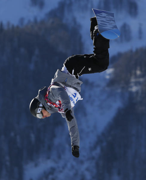 Austria's Mathias Weissenbacher takes a jump during men's snowboard slopestyle qualifying at the Rosa Khutor Extreme Park ahead of the 2014 Winter Olympics, Thursday, Feb. 6, 2014, in Krasnaya Polyana, Russia. (AP Photo/Sergei Grits)