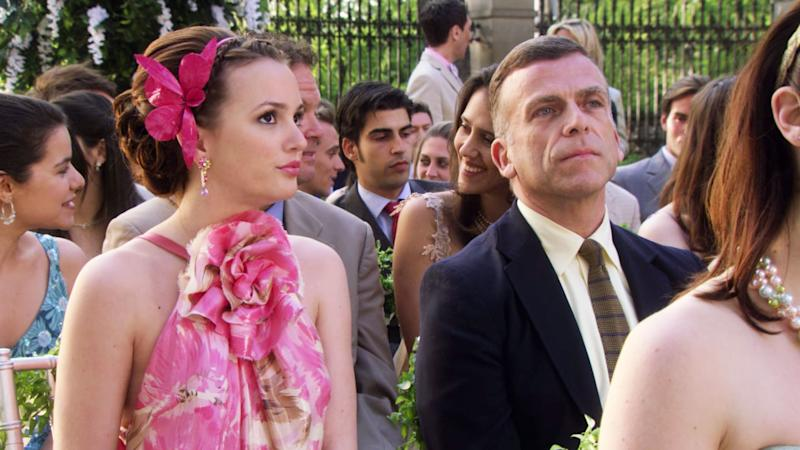 Blair matches her pink blush and lipstick to the beautiful flower head accessory that dons her updo.