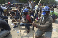 Anti-coup protesters prepare makeshift bow and arrows to confront police in Thaketa township Yangon, Myanmar, Saturday, March 27, 2021. The head of Myanmar's junta on Saturday used the occasion of the country's Armed Forces Day to try to justify the overthrow of the elected government of Aung San Suu Kyi, as protesters marked the holiday by calling for even bigger demonstrations. (AP Photo)