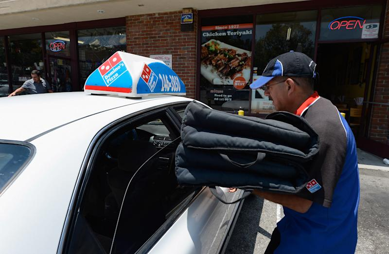 A Domino's Pizza delivery man sets out for delivery. (Photo by Kevork Djansezian/Getty Images)