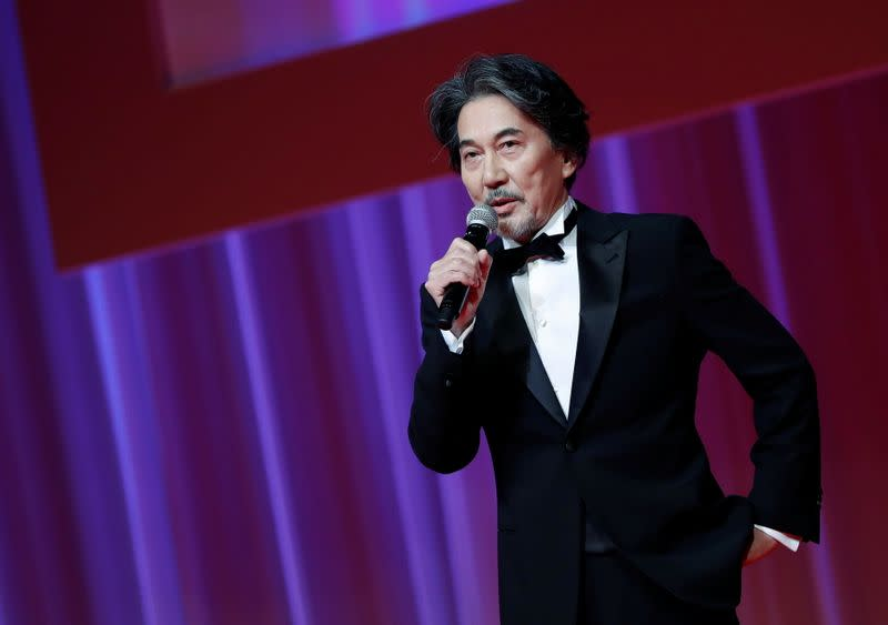 Actor and the 33rd Tokyo International Film Festival ambassador Koji Yakusho delivers a speech during the opening ceremony of the festival, amid the coronavirus disease (COVID-19) outbreak, in Tokyo
