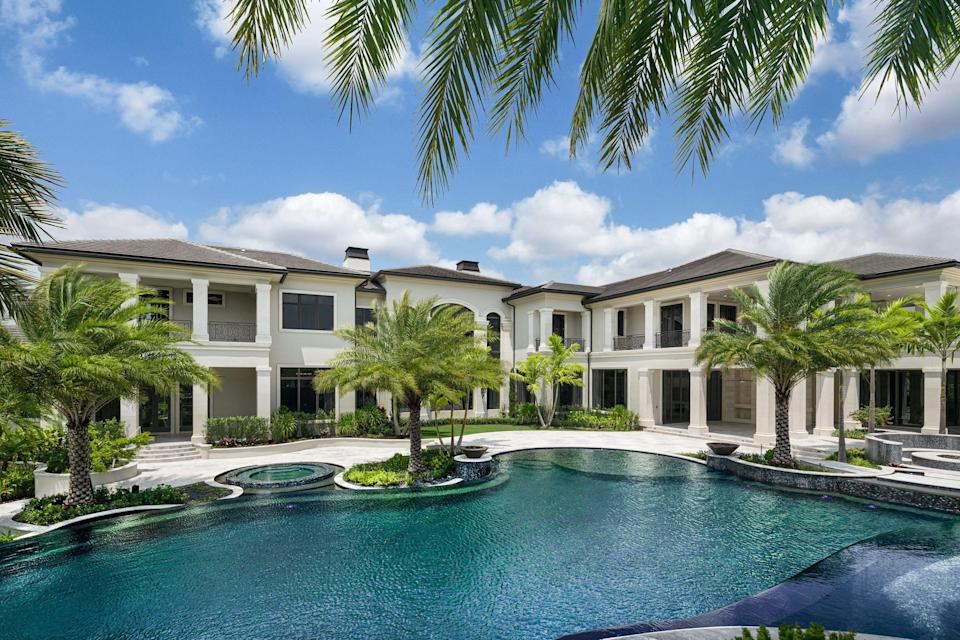 """<p>Set in the prestigious Stone Creek Ranch, the Rockybrook Estate in Florida's Delray Beach is the kind of home that surpasses even the most extreme definitions of luxury. Designed by Stuart Brenner of <a href=""""https://brennerarchgroup.com/"""" rel=""""nofollow noopener"""" target=""""_blank"""" data-ylk=""""slk:Brenner Architecture Group"""" class=""""link rapid-noclick-resp"""">Brenner Architecture Group</a>—a firm known for their resort-style compounds that start at 20,000 square-feet—the 31,000 square-foot home is designed to make everyday living feel like an escape in paradise. As one of thirty seven estates in the exclusive luxury community, the sprawling property is as impressive in its grandeur as it is in its attention to detail. From health and beauty areas (a gym, sauna, and spa) to spaces for entertaining both indoor and outdoor, the estate was designed to be shown off. Thirty two-foot walls give the interiors a breezy, beachside feel, while the Zen-like gardens (plus a waterfall feature and koi pond) will immerse you in Florida's lush landscape.</p><p>The estate is situated on 2.5 acres of land, surrounded on three sides by water and equipped with a 250,000 gallon swimming pool, so you'll always be just a short walk away from a quick dip. The property was designed for a couple and their three children, and took a total of four years to build. Stream your favorite film in the massive movie theater, or enjoy a smoke in the state-of-the-art cigar room. This is a place designed for kicking your feet up and relaxing, after all. <a href=""""https://thesenadaadzemteam.elliman.com/sales/detail/510-l-565-73_rx-10620941/9192-rockybrook-way-delray-beach-fl-33446"""" rel=""""nofollow noopener"""" target=""""_blank"""" data-ylk=""""slk:The listing"""" class=""""link rapid-noclick-resp"""">The listing</a> is held by Senada Adzem of Douglas Elliman Real Estate for $23.5 million. Take a closer look inside the over-the-top home below. </p>"""