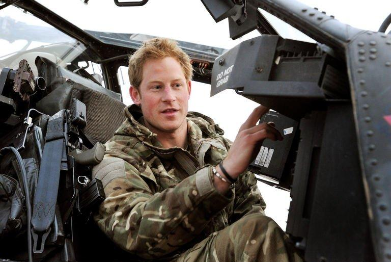 Prince Harry makes his early morning pre-flight checks at Camp Bastion in Afghanistan's Helmand Province