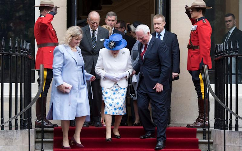 The Queen, accompanied by Prince Philip, Duke of Edinburgh (C-L) attended a function at Canada House - Credit: EPA/WILL OLIVER