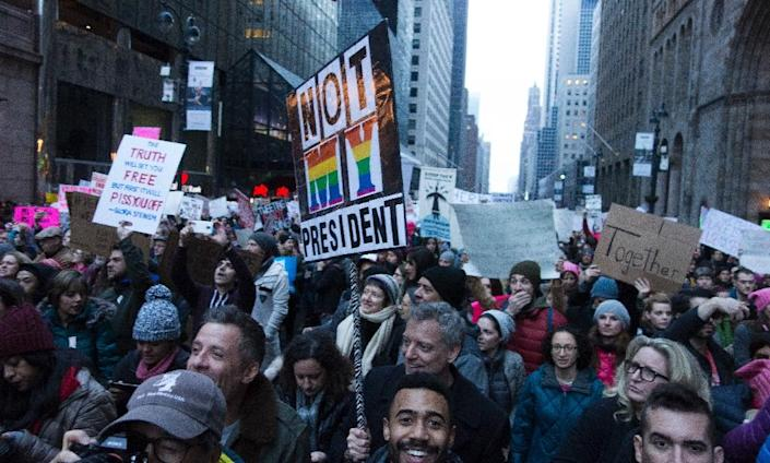 Protesters in New York, one of several marches which drew over two million people onto the streets of US cities in a stunning rebuke to the new president (AFP Photo/Don EMMERT)