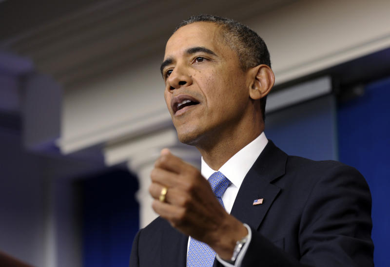 President Barack Obama speaks about the budget battle from the Brady Press Briefing Room at the White House in Washington, Monday, Sept. 30, 2013. Obama is ramping up pressure on Republicans to avoid a post-midnight government shutdown. He says a shutdown would hurt the economy and hundreds of thousands of government workers. (AP Photo/Susan Walsh)