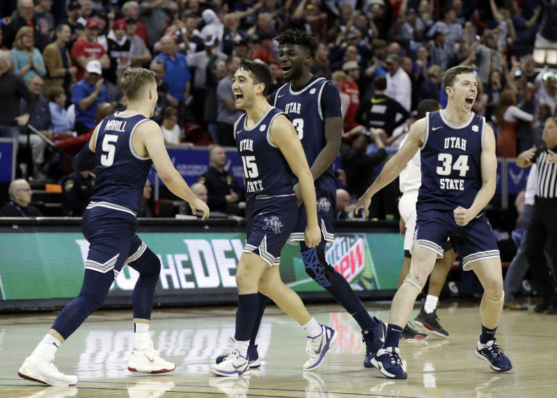Utah State reacts after Sam Merrill (5) sunk a 3-point basket with seconds remaining in the second half of an NCAA college basketball game for the Mountain West Conference men's tournament championship Saturday, March 7, 2020, in Las Vegas. (AP Photo/Isaac Brekken)